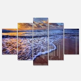 Designart 'Sunset over Blue Sea Waves' Seashore Metal Wall Art on