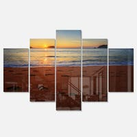 Designart 'Foot printed Sandy Ocean Beach' Seashore Metal Wall Art on