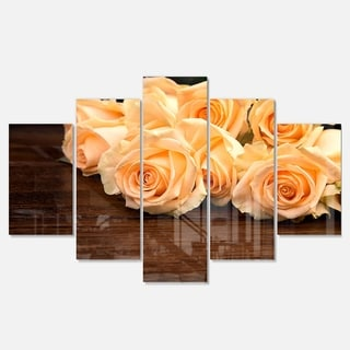 Designart 'Roses on Wooden Surface Photo' Floral Glossy Metal Wall Art