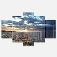 Designart 'Beautiful Seascape under Cloudy Sky' Modern Seashore Glossy Metal Wall Art