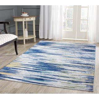 Vibrant Power-loomed Various Shades of Yellow Blue Beige and Grey Polypropylene Area Rug (7'10 x 10'6)