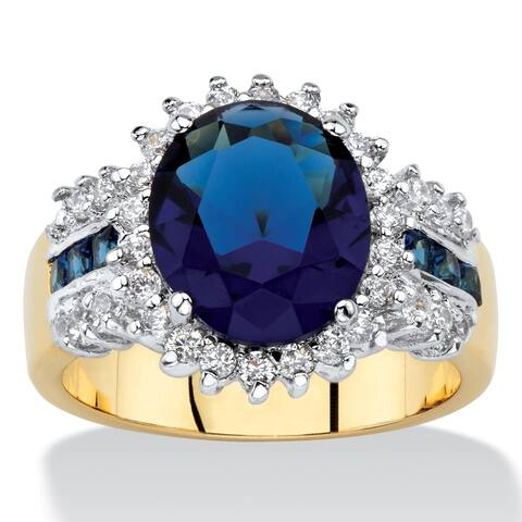 3/4ct TCW Oval-cut Simulated Blue Sapphire and White Cubic Zirconia Halo Cocktail Ring 14k