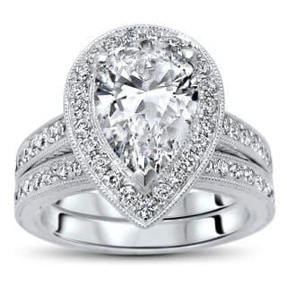 Noori 14k White Gold 1 4/5ct TGW Pear Moissanite and 3/4ct TDW Diamond Bridal Set (G-H, SI1-SI2) https://ak1.ostkcdn.com/images/products/14172343/P20771511.jpg?impolicy=medium