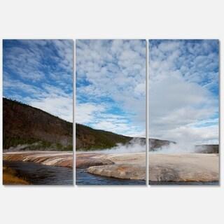 Designart 'Yellowstone under Bright Clouds' Landscape Glossy Metal Wall Art