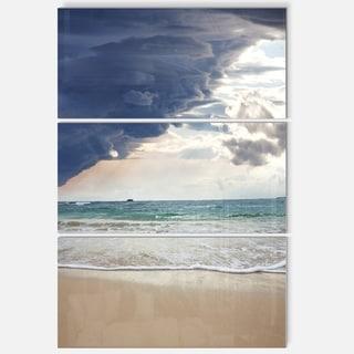 Designart 'Heavy Clouds over Pacific Ocean' Seashore Glossy Metal Wall Art
