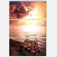 Designart 'Stunning Beach with Old Bridge' Seashore Glossy Metal Wall Art