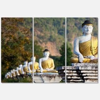 Designart 'Beautiful Row of Buddha Statues' Oversized Landscape Glossy Metal Wall Art