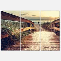 Designart 'Vintage Wooden Bridge To Seashore' Large Seashore Glossy Metal Wall Art