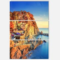 Designart 'Manarola Village View At Sunset' Beach Glossy Metal Wall Art