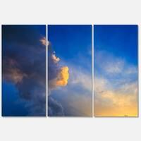 Designart 'Dramatic Sunset Sky with Thunderstorm' Beach Glossy Metal Wall Art