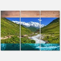 Designart 'River in Caucasus Mountains' Landscape Glossy Metal Wall Art