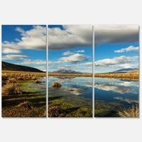 Designart 'Clouds Reflecting in Mountain Lake' Oversized Landscape Glossy Metal Wall Art