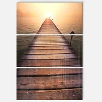 Designart 'Long Wooden Boardwalk into Sea' Large Seashore Glossy Metal Wall Art