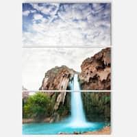 Designart 'Amazing Waterfall under Cloudy Sky' Oversized Landscape Glossy Metal Wall Art