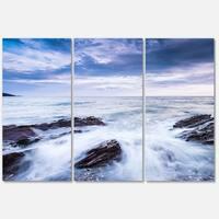 Designart 'Waves Crashing At Beach' Seashore Glossy Metal Wall Art