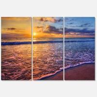 Designart 'Sunset over Blue Seashore' Seashore Glossy Metal Wall Art