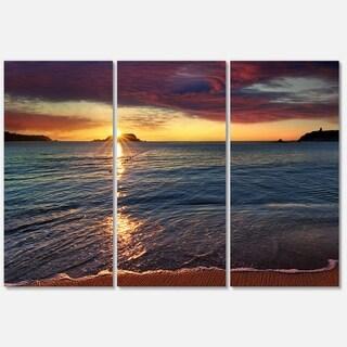 Designart 'Beautiful Clear Seashore at Sunset' Seashore Art Glossy Metal Wall Art