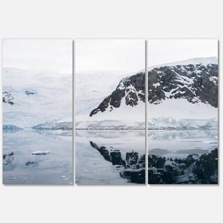 Designart 'Snowcap Hill in Antarctica' Seashore Art Glossy Metal Wall Art