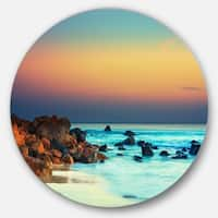 Designart 'Sunset Over Blue Sky' Seascape Photography Round Metal Wall Art