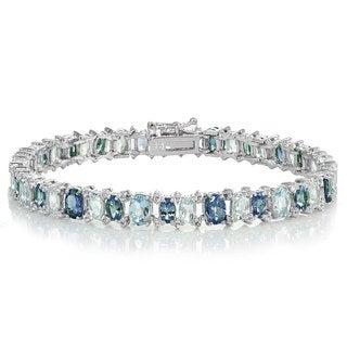 Glitzy Rocks Sterling Silver Tanzanite, Blue and White Topaz Oval Bracelet