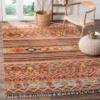 Safavieh Nomad Hand-knotted Wool Multi Area Rug - 6' x 9'