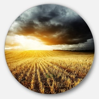 Designart 'Storm Dark Clouds over Wheat Stems' Landscape Circle Wall Art