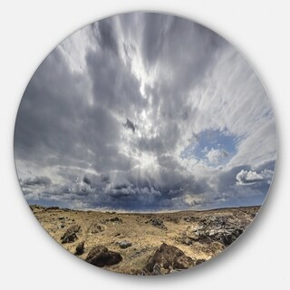 Designart 'Sky and Stones under Dark Clouds' Landscape Circle Wall Art