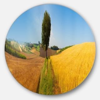 Designart 'Tuscany Wheat Field Hill Panorama' Landscape Large Disc Metal Wall art