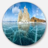 Designart 'Lake Baikal Ice and Rocks Panorama' Seascape Disc Metal Artwork