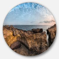 Designart 'Rough Rocky Coast under Blue Sky' Beach Circle Wall Art