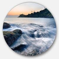 Designart 'Slow Motion Sea Waves over Rocks' Modern Seascape Large Disc Metal Wall art