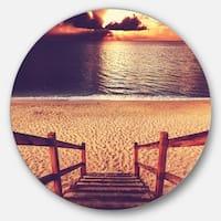 Designart 'Wood Boardwalk in Beach at Evening' Sea Bridge Disc Metal Artwork