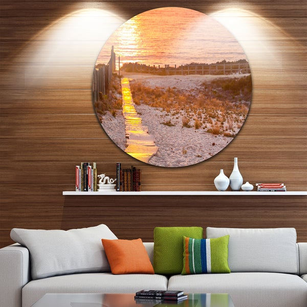 Designart 'Yellowish Boardwalk into Seashore' Sea Bridge Round Metal Wall Art