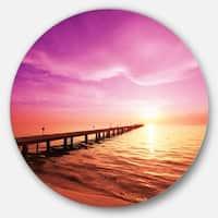 Designart 'Brown Sea and Pier under Magenta Sky' Sea Bridge Round Wall Art