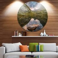 Designart 'Mountain Lake over Skok Waterfall' Seashore Round Wall Art