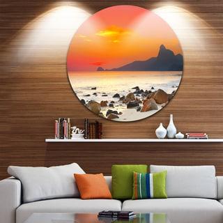 Designart 'Rocky Seashore under Colorful Sky' Seascape Disc Metal Artwork