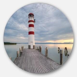 Designart 'Lighthouse at Lake Neusiedl at Sunset' Sea Bridge Round Wall Art