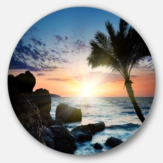 Designart 'Lonely Palm Tree on Rocky Beach' Modern Seashore Round Metal Wall Art