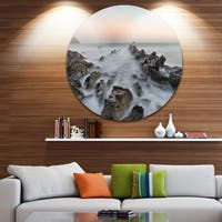 Designart 'Rocky Beach with White Waters' Modern Seashore Round Metal Wall Art