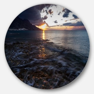 Designart 'Gloomy Sea Coast at Sunrise' Modern Seashore Round Wall Art