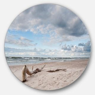 Designart 'Piece of Wood on Beach' Modern Seascape Round Metal Wall Art
