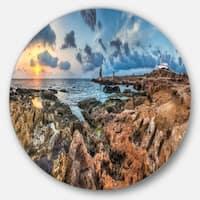 Designart 'Blue Sky over Rough Rocky Coast' Seashore Disc Metal Artwork