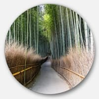 Designart 'Straight Path in Bamboo Forest' Forest Round Metal Wall Art
