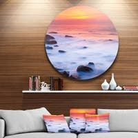 Designart 'Bright Red Rocky Coast Sunset' Seashore Round Metal Wall Art