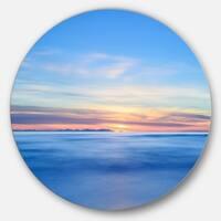 Designart 'Corsica Island Sunset View Italy' Seashore Round Metal Wall Art