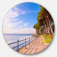 Designart 'Promenade and Pine Trees in Italy' Landscape Large Disc Metal Wall art