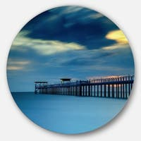 Designart 'Wooden Pier and Turquoise Seashore' Sea Pier and Bridge Round Metal Wall Art