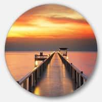 Designart 'Yellowish Sky and Long Wooden Bridge' Sea Pier and Bridge Round Wall Art
