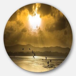 Designart 'Glittering Sun Among heavy Clouds' Seashore Round Wall Art