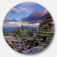 Designart 'Piled Stones in Summer Mountains' Landscape Photo Disc Metal Wall Art